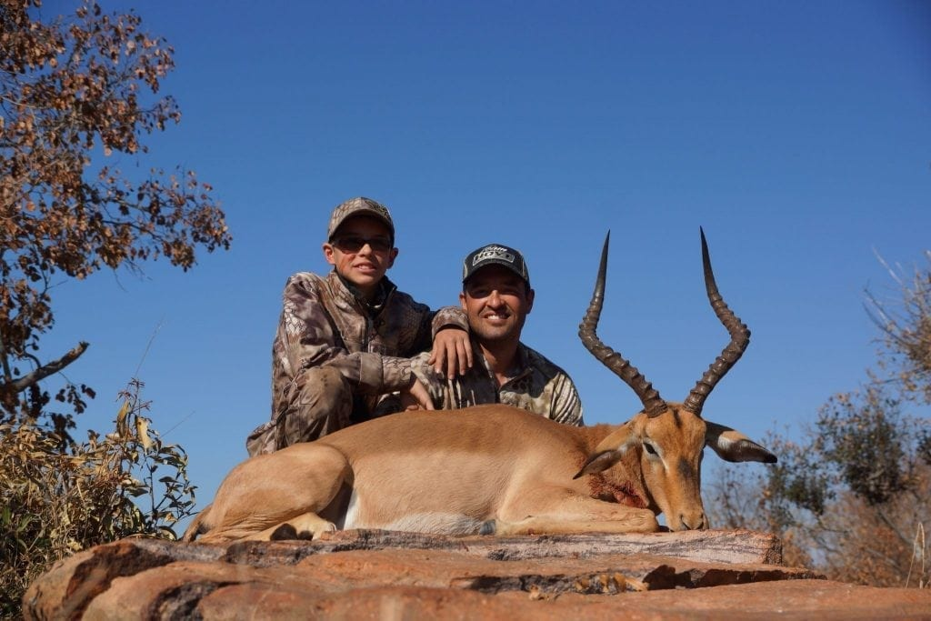 Cory and his son Webb with an impala
