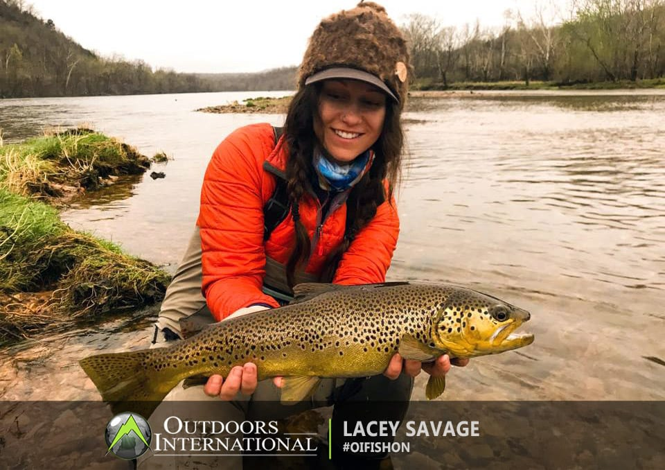 Another big brown trout for Lacey while fly fishing Arkansas.