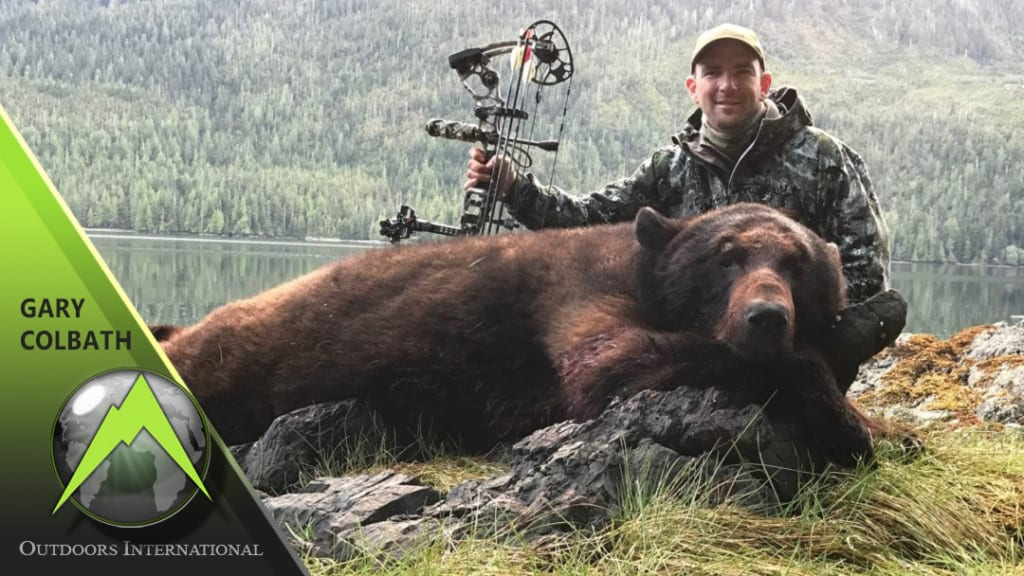 OUTDOORS INTERNATIONAL Hunting Consultant Gary Colbath with a great color-phase Alaska black bear.