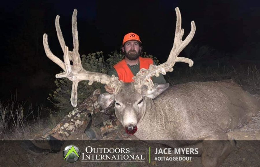 "Jace Myers with his giant Colorado ""cactus buck"" mule deer."