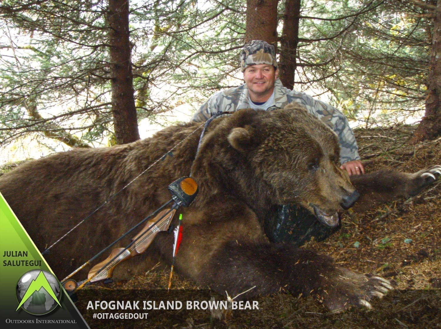 "Outdoors International Hunting Consultant, Julian Salutegui with his giant 9' 10"" brown bear he took on Afognak Island with a recurve."